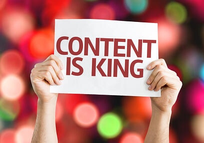 Content is King card with colorful background with defocused lights