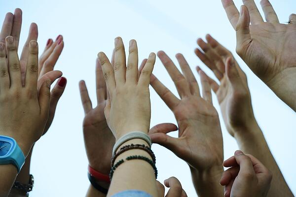 Group raising hands