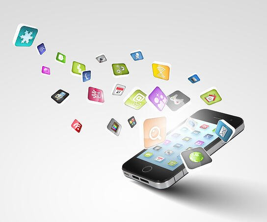 Many illustrated graphical icons flowing out of a mobile phone