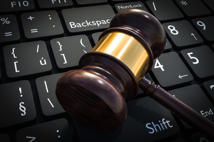 Gavel in ADA lawsuit laying on laptop keyboard