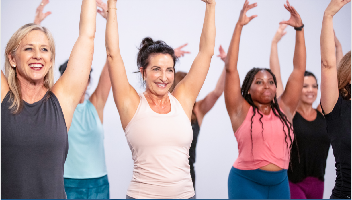 Women taking a Jazzercise class